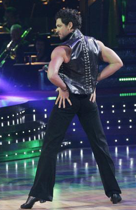 Maksim strikes a Dancing with the Stars pose