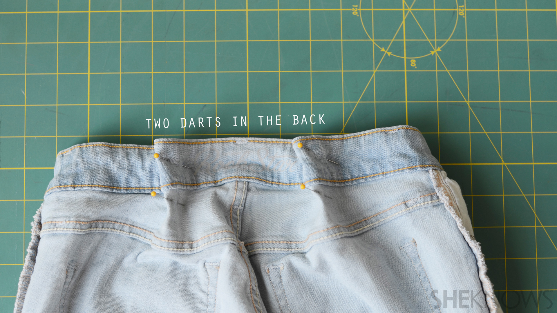 Pin two darts into the back of the pants