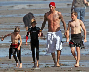 David Beckham and boys on beach