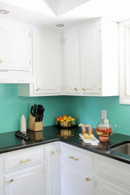 bright blue backsplash white kitchen