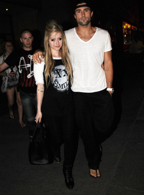 Brody Jener and Avril Lavigne leaving an event