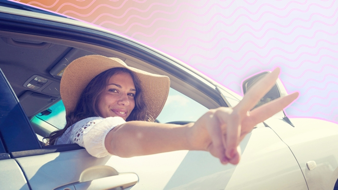 Woman making a peace sign while
