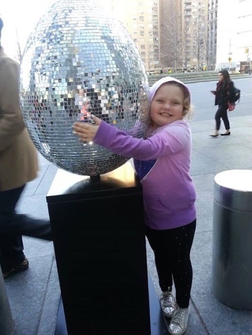 Honey Boo Boo hugging a mirrored eggs snapped ball in April 2013