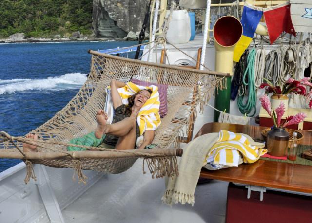 Debbie Wanner lays in hammock on Exile Island during Survivor: Game Changers