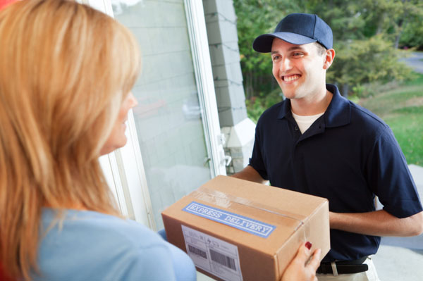 Delivery man handing woman a package