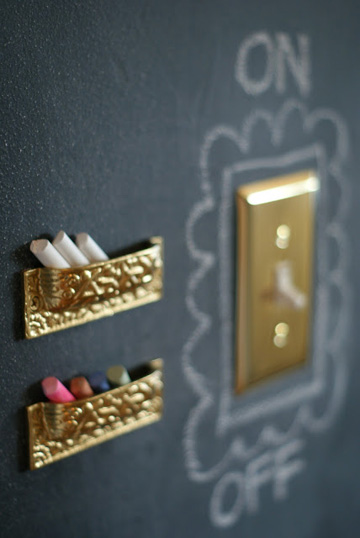 Chalkboard walls are all the rage in kid spaces these days and upside down drawer pulls keeps chalk pieces contained.