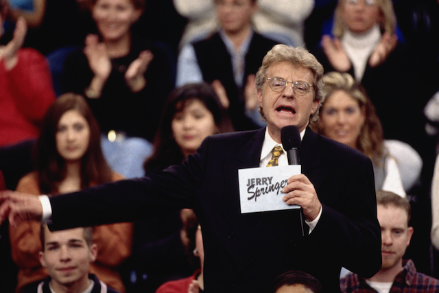 Jerry Springer talks to his guests and audience on the set of 'The Jerry Springer Show'