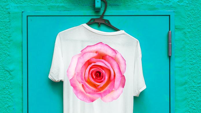 Flower T-shirt hanging on blue door