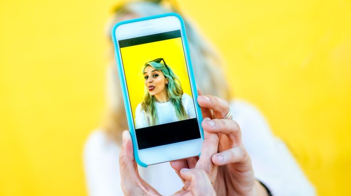 Close-up of woman's hands taking selfie