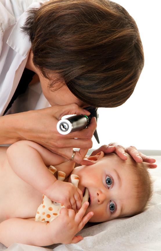 Doctor looking in baby's ear