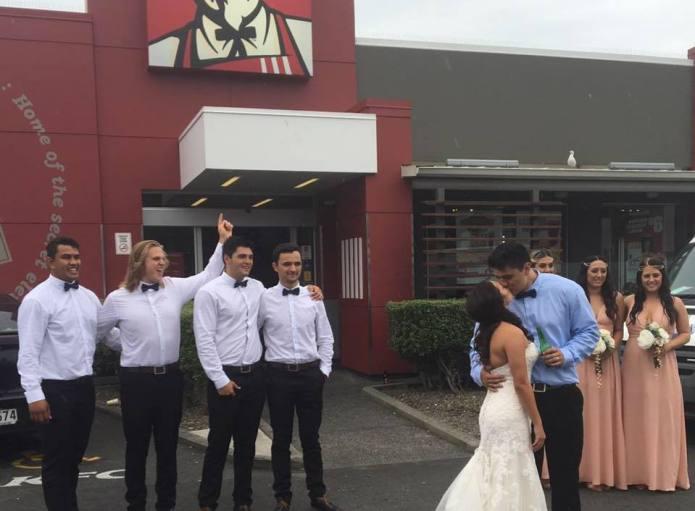 Couple celebrates wedding by taking photos
