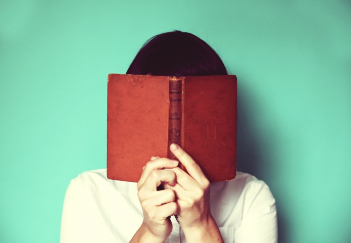 Woman's holding a book in front