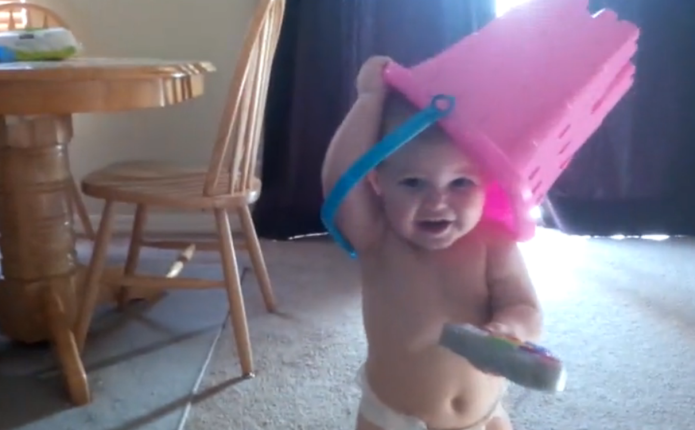This toddler playing peekaboo puts all