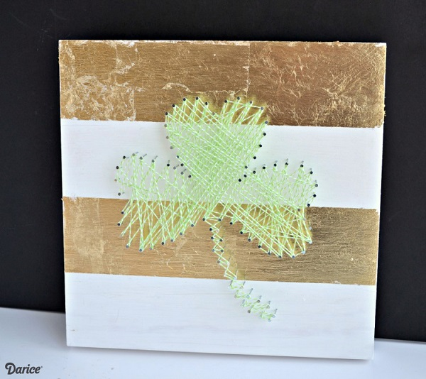 Shamrock string art on gold and white background