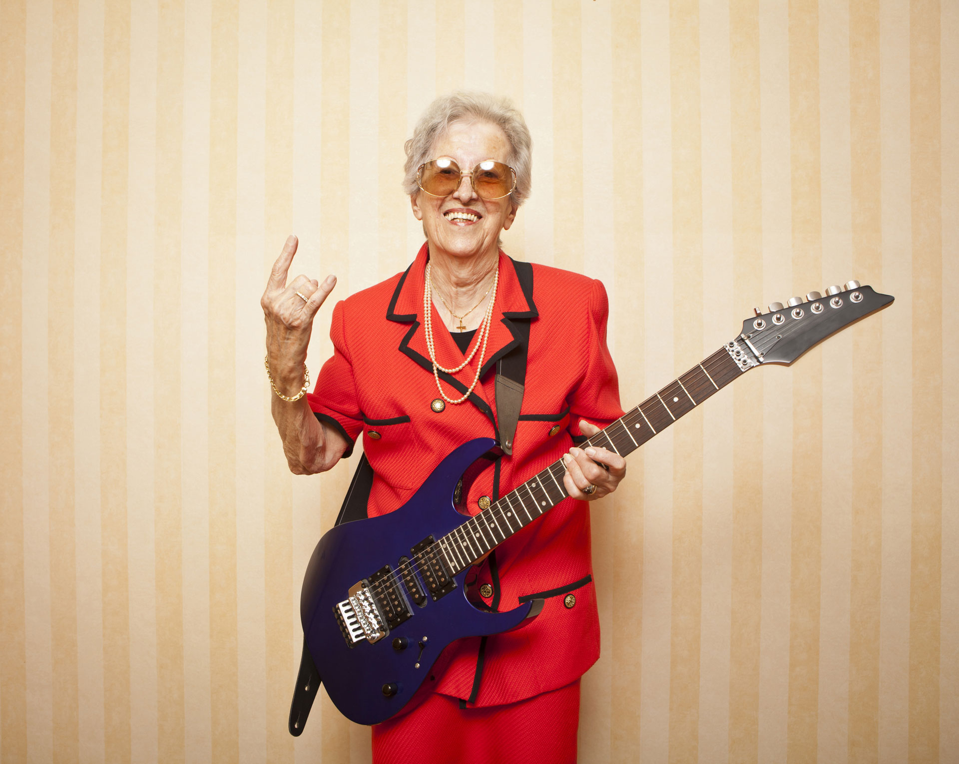 Cool fashion elder lady with electric guitar