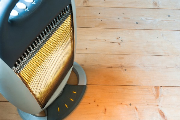 electric space heater on wood flooring