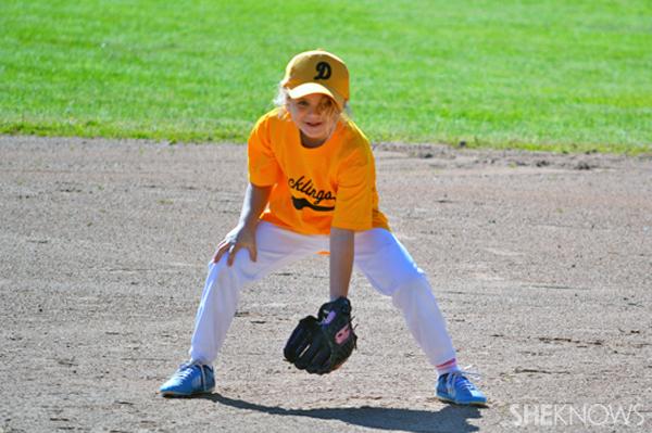 Eliza Walmark playing baseball