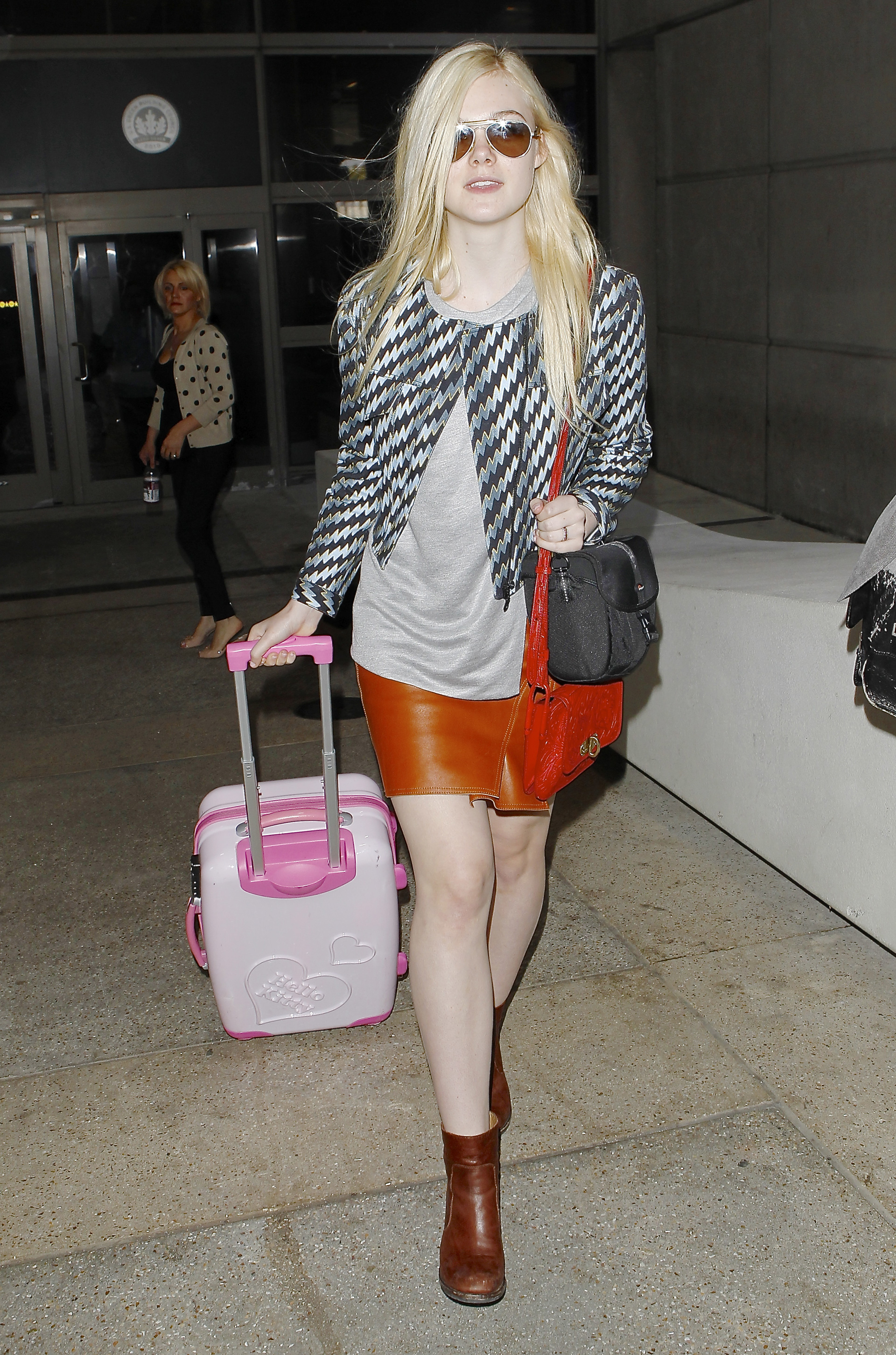 Elle Fanning arriving at airport