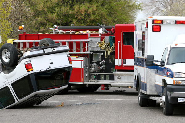 Emergency workers at rollover accident
