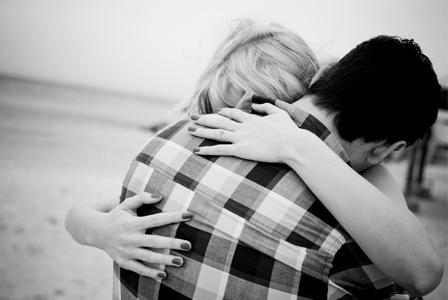 Emotional couple embracing