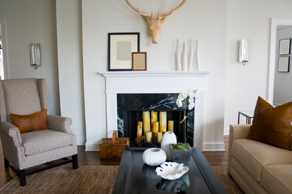 Empty fireplace with candles