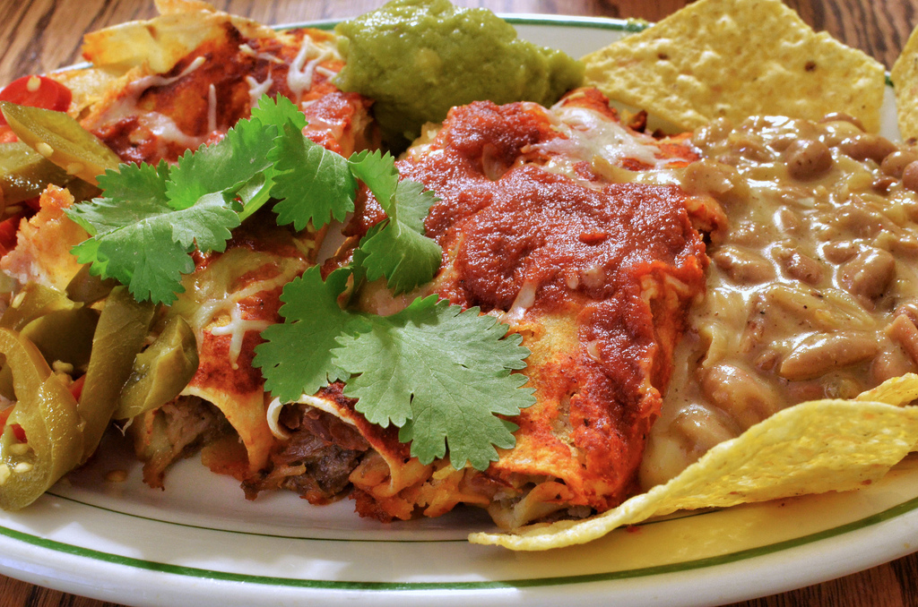 a plate of enchiladas with beans