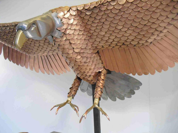 An eagle made out of pennies
