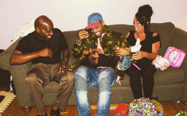 Chris Brown with his parents and daughter, Royalty