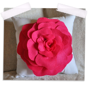 Hot pink rose on white pillow