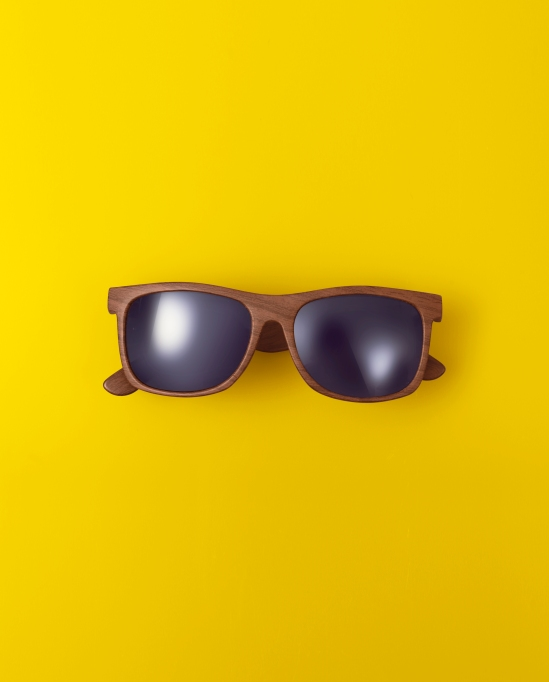 Sunglasses against yellow background