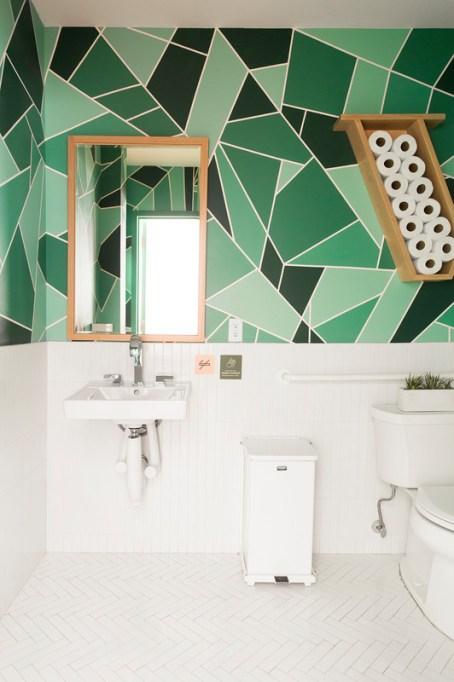 Green geometric pattern on bathroom wall