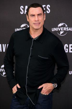 John Travolta sings the Christmas classics