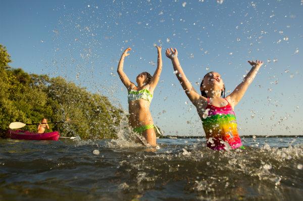 Family swimming at the lake