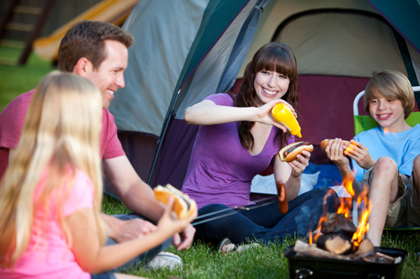 Family camping in backyard