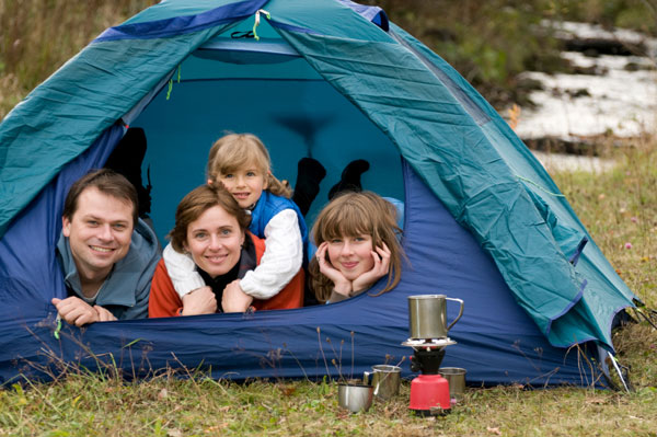 Family camping in a tent in the fall