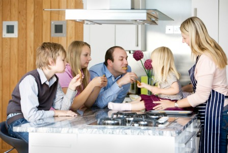 Family in the kitchen | Sheknows.com
