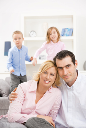 Family in clutter-free family room