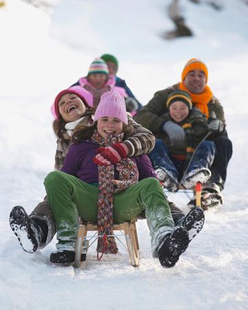 Family on sleds