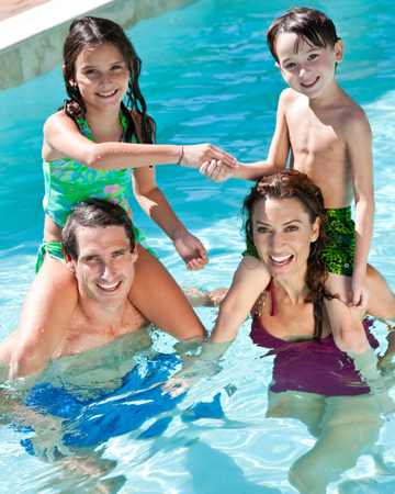 Family playing in the pool