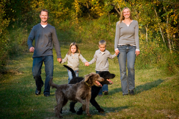 happy, healthy kids walking with dog