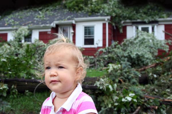 Little Girl in front of Fallen Tree