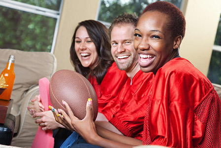 fans watching football on couch