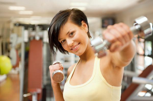 Fashionable woman exercising