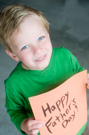 Boy with Homemade Father's Day Card