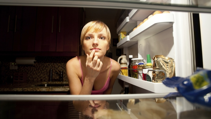 Woman thinking about her food choice