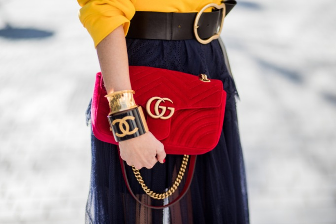 Wearing stacked bangles with red clutch