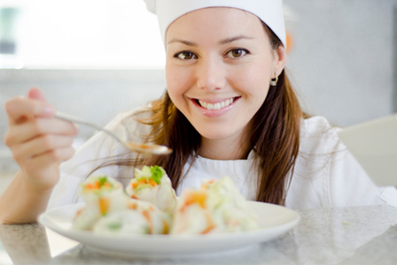 Female chef cooking