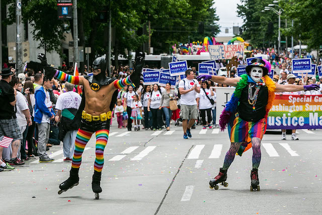 Attendees and marchers on the streets of downtown Seattle for the 40th Annual Seattle Pride Parade