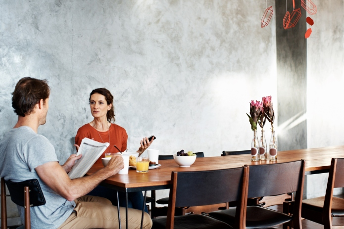 Shot of a couple eating breakfast