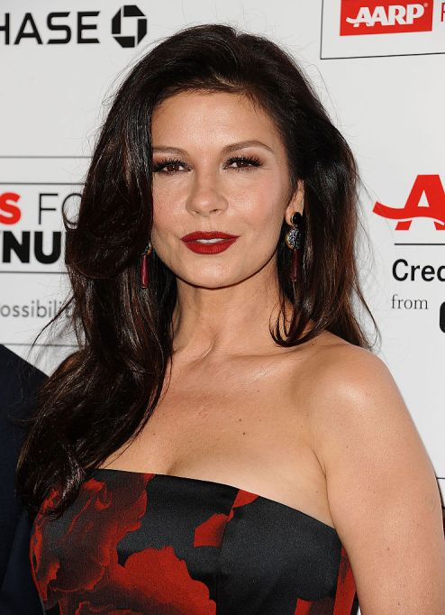 Catherine Zeta-Jones with red lipstick and a red and black dress